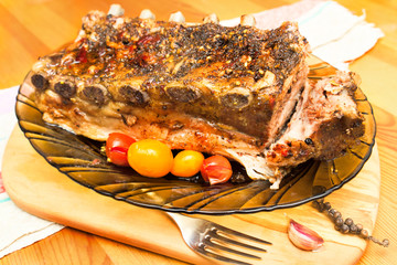 barbecued grilled ribs seasoned with hot spices and tomatoes