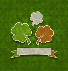 Holiday background with clovers in Irish flag color for St. Patr
