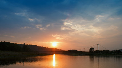 Beautiful sunset with clouds an sky and river, time lapse.