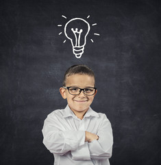 Smart boy with solution idea lightbulb above head