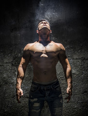 Shirtless Muscle Man Looking Up Into Bright Overhead Light