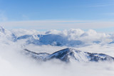 View on mountains and blue sky above clouds