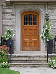 front door with flower pots