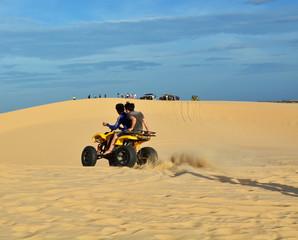 People on ATV in desert
