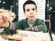 Child eat in fast food restaurant.