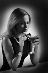 Woman sipping her cocktail