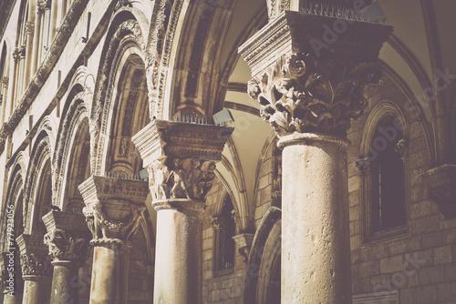 Zdjęcia na płótnie, fototapety, obrazy : Gothic Stone Pillars in Retro Film Style