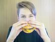 Boy eats a hamburger