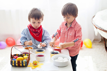 Two boys, coloring eggs for Easter
