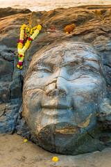 closeup facial image of Shiva on the beach
