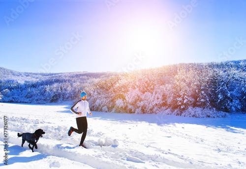 Man jogging in winter nature - 77926077