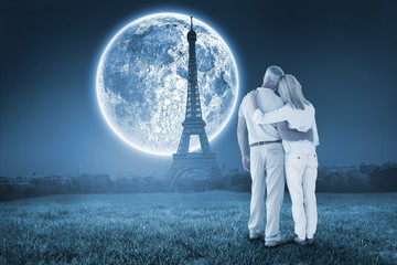 Composite image of happy couple standing and looking
