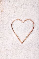 coconut flakes scattered in the form of heart