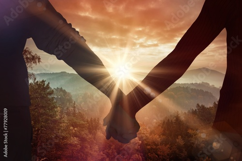 Staande foto Bomen Composite image of couple holding hands rear view