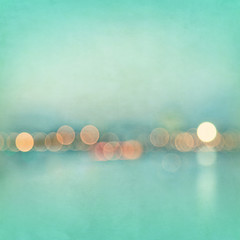 Blurred cityscape background with bokeh effect. Grunge and retro