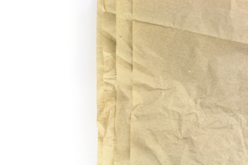 Old recycled blank crumpled papers fringes background on white
