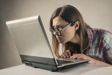 Nerd girl working at pc