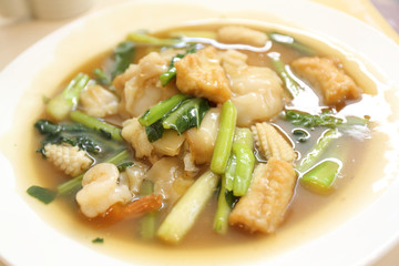 Thai food Wide Noodles in a Creamy Sauce with seafood