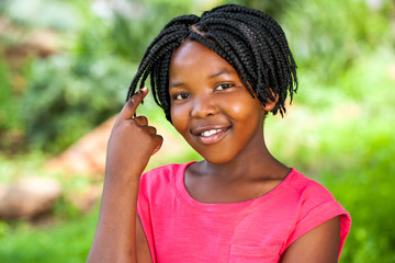 Cute African girl showing braided hair.