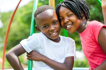 Face shot of African kids in park.