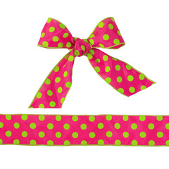 Pink  and green polka dot bow with ribbon isolated on white