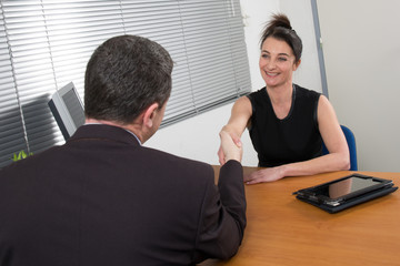 lovely female employer interviewing a candidate
