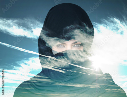 Double exposure of woman wearing burqa and cloudscape - 77932095