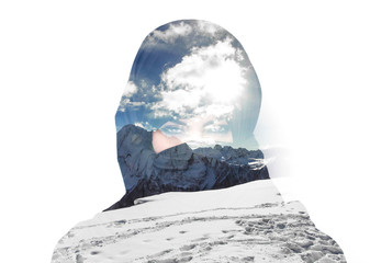 Double exposure of woman wearing burqa and mountainscape