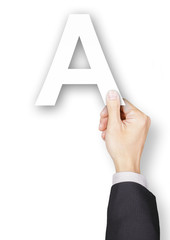 Hand of businessman holding paper alphabet A