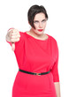 Beautiful plus size woman with thumbs down gesture isolated on w