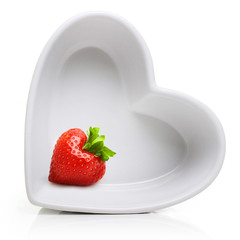 Red berry strawberry in heart shape plate