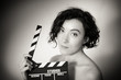 Seductive actress with clapperboard, vintage black and white clo