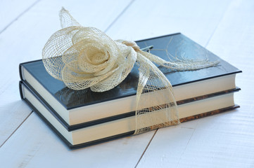Two books tied with a raffia ribbon