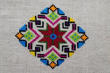 Ornament- ethnic Ukrainian embroidery on cannabic canvas