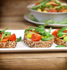 Vegetarian sandwiches and fresh salad in bowl