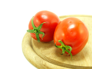 tomato on wooden chopping board isolated on white background
