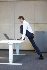 exercises in office. business man  stretching