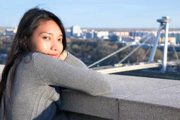 Young woman do watch on SNP bridge in Bratislava