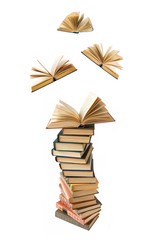 Book pile with open books flying awa