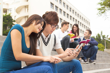 young couple student touching the smartphone