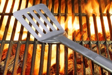 Spatula on the Hot Flaming Grill