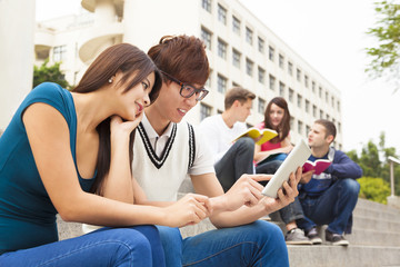 young couple student watching  the tablet
