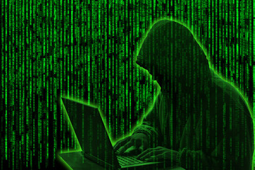 Conceptual image of a hacker on green matrix background