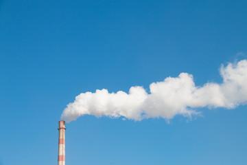 Factory chimney in winter