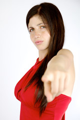 Angry woman pointing finger isolated