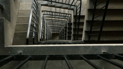 High rise concrete stairwell tracking shot.