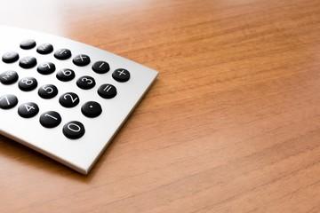 vintage calculator on plain wooden desk