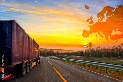 Truck on road on Europe map background - shipping travel concept - 77944485