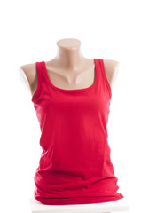 Female red shirt on a mannequin isolated on white background.