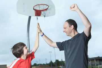 Young Boy In Basketball who having fun